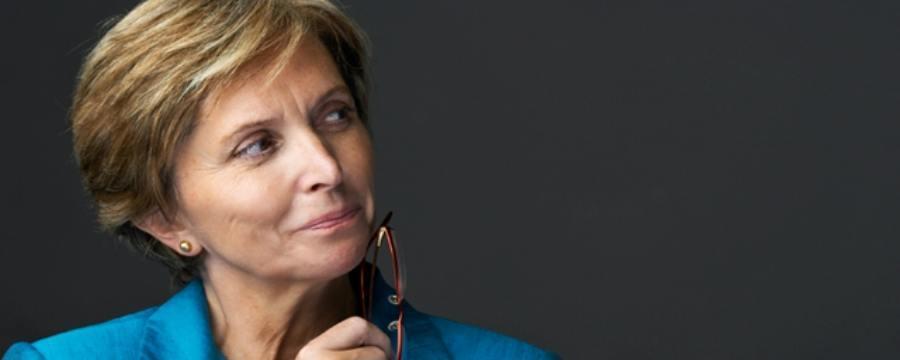 Biz Woman Thinking about Whole Life & Universal Life Insurance